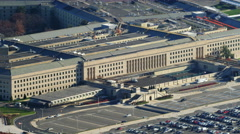 Zoom-out on the Pentagon to reveal nearby Virginia landscape and Washington DC - stock footage