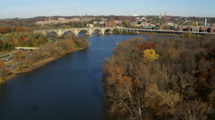 Flying above the Potomac River toward and over Key Bridge approaching Georgetown Stock Footage