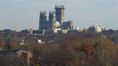 Flying past Washington National Cathedral with trees in foreground. Shot in Stock Footage