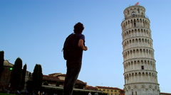 Tourist Man Admires Leaning Tower Pisa Italy 4K Stock Footage Stock Footage