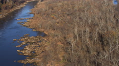 Over autumn woods along the Potomac toward Chain Bridge, Virginia shoreline on Stock Footage