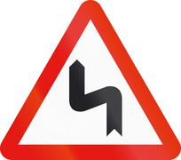 Road sign used in Spain - Dangerous Curves left - stock illustration