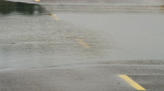 Close up of pavement disappearing under flood water Stock Footage