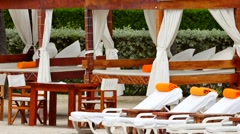 Beach club lounges Stock Footage