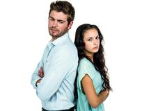Stock Photo of Couple back to back not talking after argument