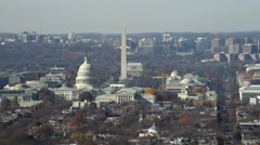 Over Capitol Hill, looking toward National Mall with Capitol rotunda, Washington - stock footage