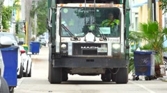 Garbage truck in the alley Stock Footage