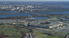 Wide view of the Pentagon with Washington DC across Potomac in background; - stock footage