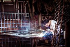 An asian is working on welding task, Hong Kong Stock Photos