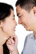 Cheerful man adoring woman - stock photo