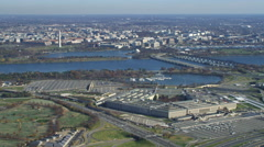 Wide view of the Pentagon with Washington DC across river in background. Shot in - stock footage
