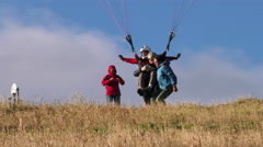 Assisted Takeoff Of A Tandem Paraglide Stock Footage