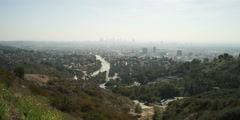 Distant view of Highway 101 and smoggy downtown Los Angeles from Hollywood Bowl - stock footage