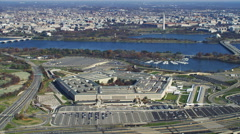 Approaching the Pentagon; Washington DC across Potomac in background. Shot in - stock footage