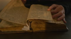 Monk's Hands Leafing Through Ancient Book Candlelight Tale of Bygone Years Monk - stock footage