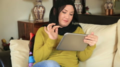 Muslim woman using digital tablet Stock Footage