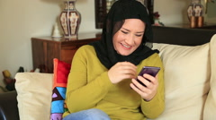 Muslim woman using smart phone 2 Stock Footage