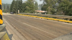 Wooden deck bridge rural, single cars passes Stock Footage