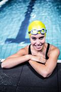 Swimmer woman lean on the edge of the swimming pool - stock photo