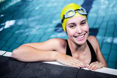 Stock Photo of Swimmer woman lean on the edge of the swimming pool