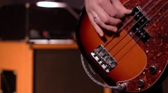 Bassist. Close-up on a male hand playing bass Stock Footage