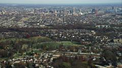Over residential area and cemetery, approaching downtown Baltimore, MarylandShot Stock Footage