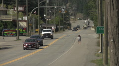 Small town traffic, establishing shot with light traffic, late summer Stock Footage