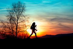 Nordic walking in the mountains at sunset Stock Photos