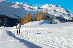 Woman practicing cross-country skiing - stock photo
