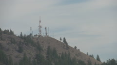 Microwave towers on mountain top Stock Footage