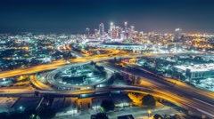 Aerial view freeway interchange downtown Los Angeles skyline night timelapse 4K Stock Footage