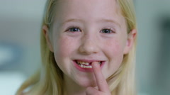 4K Little girl opening her mouth to show where she has lost one of her teeth Stock Footage