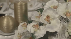 Scenery. Candles and flowers of orchids Stock Footage
