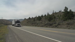 transportation generic transport truck climbs hill, through frame - stock footage