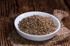 Heap of dried Anise Seeds - stock photo