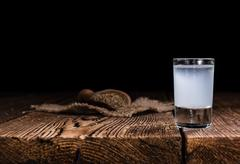 Ouzo on wooden background Stock Photos
