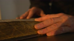 Monk's Hands Touching a Manuscript Reading Candlelight Tale of Bygone Years - stock footage