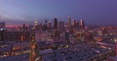 Aerial view city downtown Los Angeles skyline sunset twilight dusk night. 4K UHD Arkistovideo