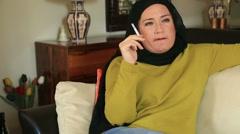 Sad muslim woman smoking cigarette Stock Footage