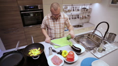 Stock Video Footage of Man Cut the Green Pepper on the Board Kitchen