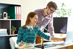 Young woman and man working from home - modern business concept Stock Photos