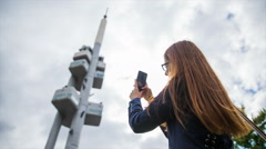 Female tourist photographing Zizkov Television Tower Stock Footage