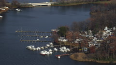 Orbiting small marina and park along the river east of Baltimore, Maryland. Shot Stock Footage