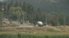 transportation several trucks passing highway junction late summer - stock footage