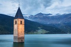 Famous Bell Tower of the Sunken church in Resia Lake, Italy. Kuvituskuvat