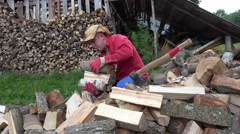 Man take wood in arms stack near woodshed. 4K Stock Footage