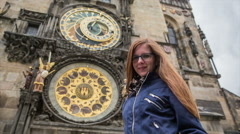Stock Video Footage of Woman portrait shot in front Prague astronomical clock