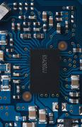 Stock Photo of Electronic circuit board with processor macro photo