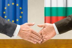 Representatives of the EU and Bulgaria shake hands - stock photo