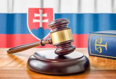 A gavel and a law book - Slovakia - stock photo